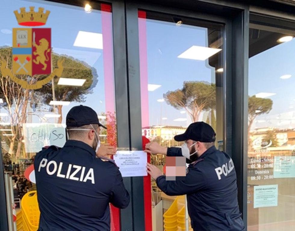 immagine polizia chiusura negozi
