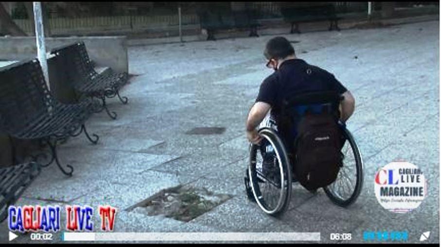 immagine marco girau sulla sedia a rotelle